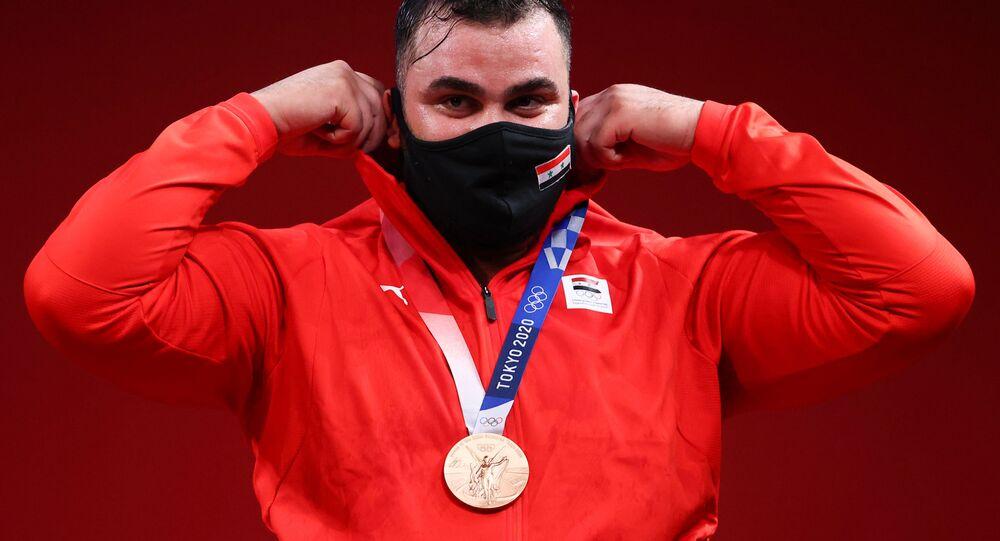 الرباع السوري صاحب برونزية رفع الأثقال في أولمبياد طوكيو ، معن أسعد