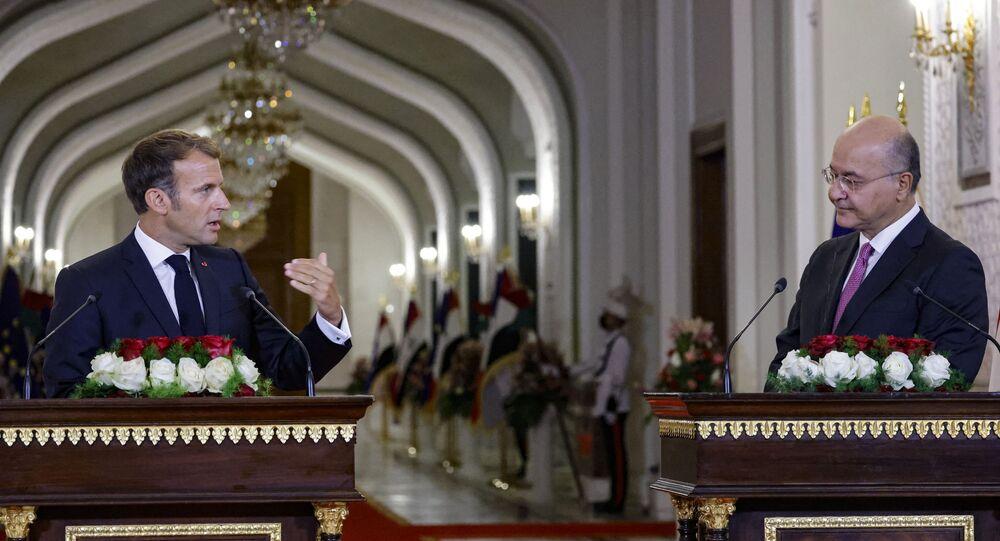 الرئيس العراقي برهم صالح والفرنسي إيمانويل ماكرون