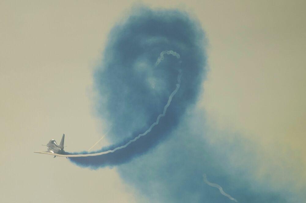 فريق الاستعراض الجوي الأول من أغسطس التابعة لسلاح الجوي الصيني، في معرض الصين الدولي للطيران والفضاء، أو معرض الصين الجوي، في تشوهاى، مقاطعة قوانغدونغ، الصين  28 سبتمبر 2021.