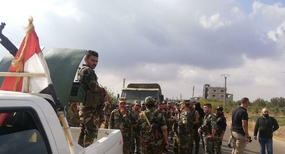مسلحو أكبر مدن ريف درعا يسلمون أسلحتهم للجيش السوري