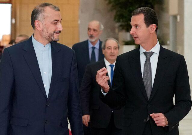 الرئيس السوري بشار الأسد مع وزير الخارجية الإيراني حسين أمير عبد اللهيان
