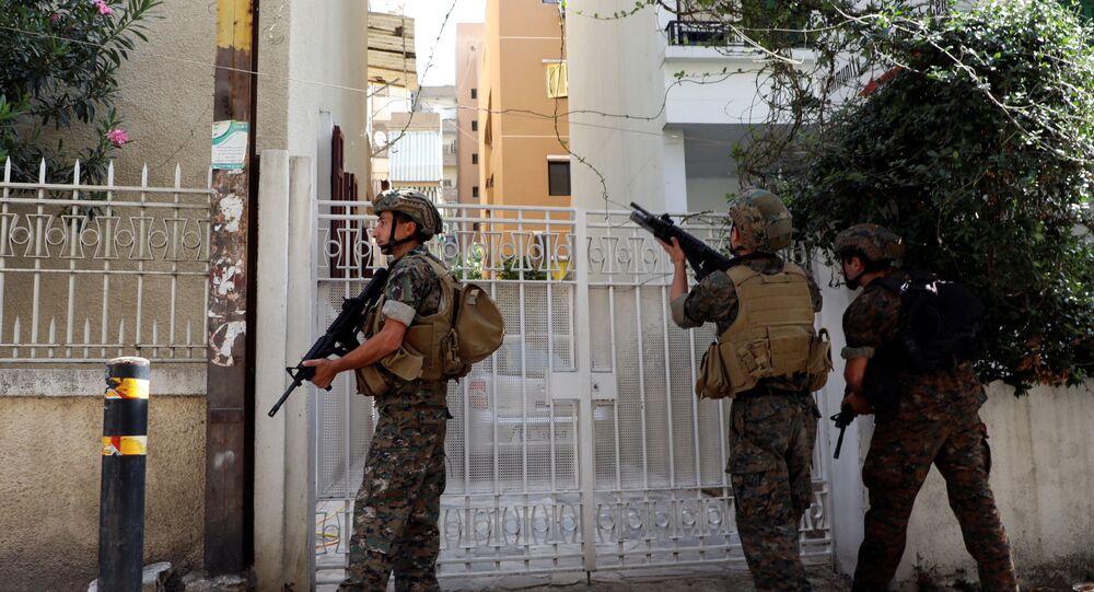 اشتباكات عنيفة وقوع إصابات في بيروت، لبنان 14 أكتوبر 2021