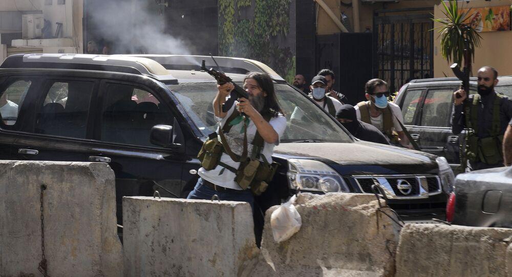 أنصار حزب الله خلال الاشتباكات في حي الطيونة، بيروت، لبنان 14 أكتوبر 2021