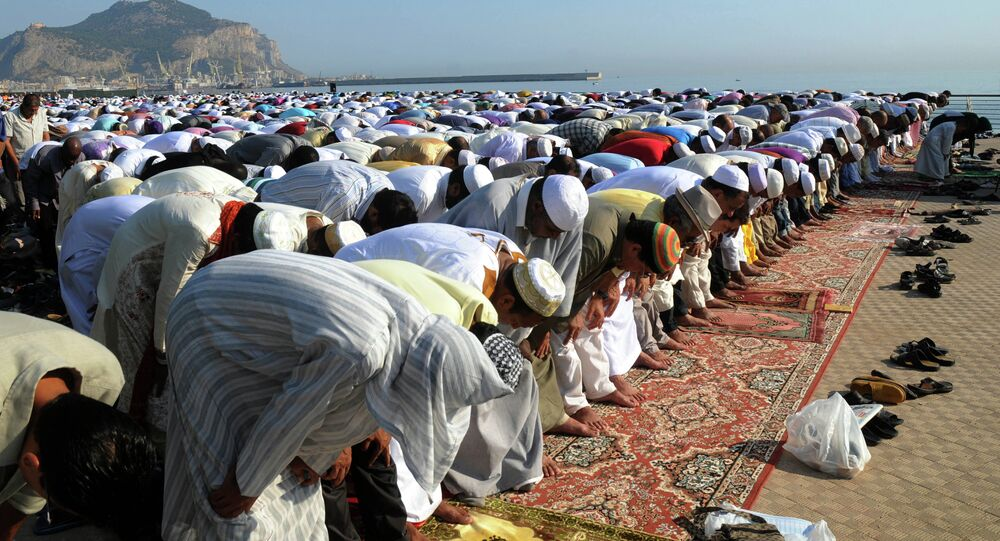 Muslims pray during Eid al-Fitr prayer, which marks the end of the holy month of Ramadan, in Palermo, Italy, Sunday, Aug. 19, 2012