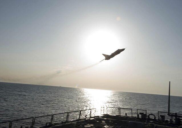 طائرة روسية تحلق قرب بارجة حربية أمريكية
