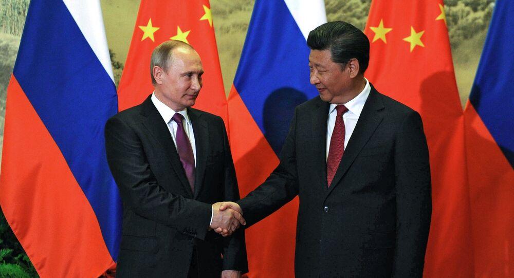 زيارة بوتين إلى الصين