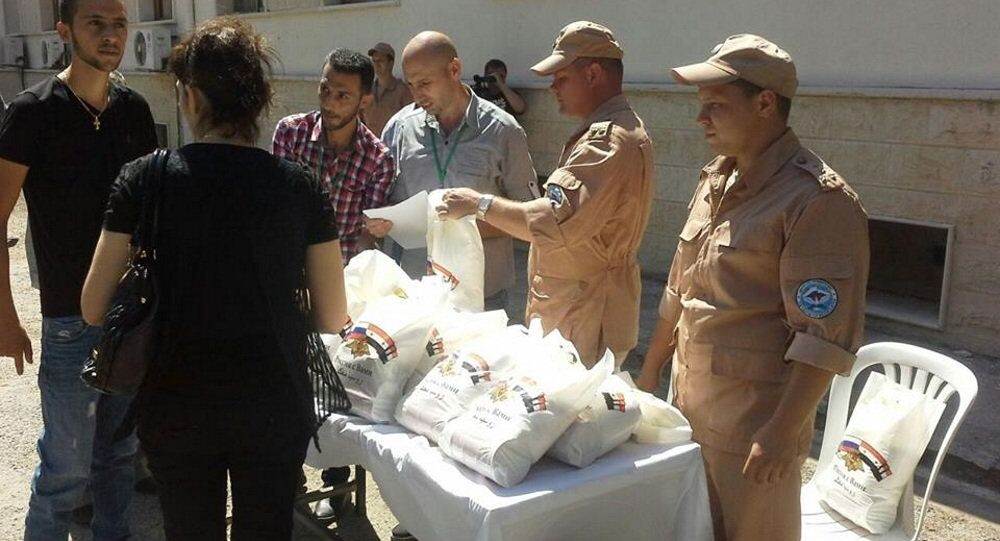 مساعدات انسانية روسية سورية مشتركة في ريف حمص الغربي