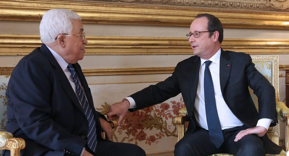 الرئيس الفرنسي هولاند والرئيس الفلسطيني محمود عباس