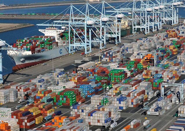 Shipping containers sit at the ports of Los Angeles and Long Beach, California in this aerial photo taken February 6, 2015