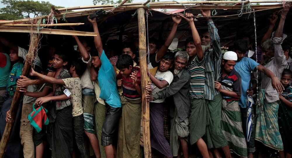 اللاجئون - لاجئو الروهينغا في مخيم بالوخالي للاجئين بالقرب من كوكس بازار، بنغلادش 11 ديسمبر/ كانون الأول 2017