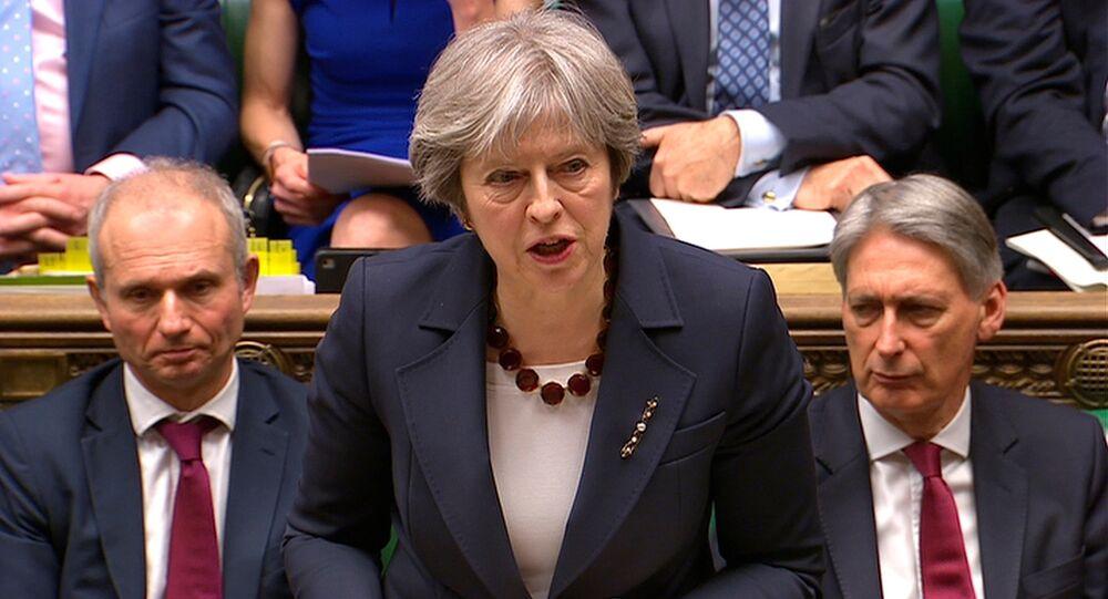 رئيسة الوزراء البريطانية تيريزا ماي تتحدث أمام مجلس العموم البريطاني، لندن، بريطانيا 14 مارس/ آذار 2018
