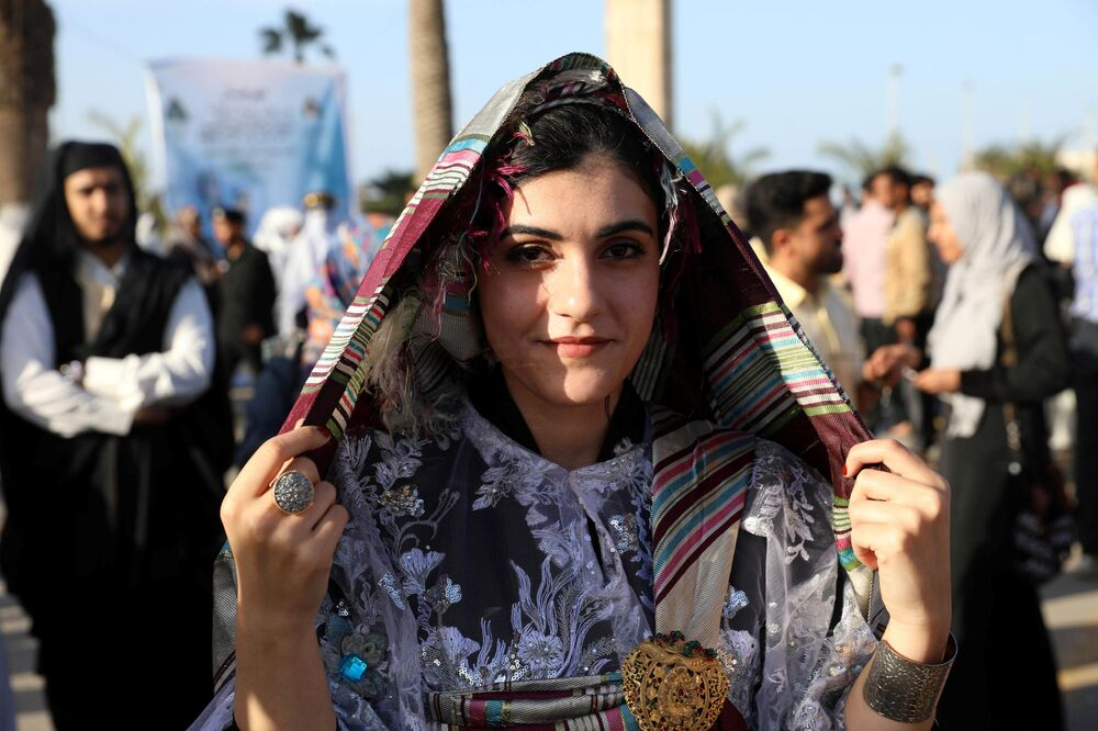 إحدى المشاركات في المهرجان الوطني للزي التقليدي في طرابلس، ليبيا 13 ماري/ آذار 2018