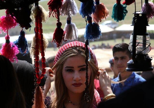 مهرجان ثقافي بالقرب من جبال مقلوب، التي تقع على بعد 30 كيلومترا من شمال شرق الموصل في العراق، 5 أبريل/ نيسان 2018