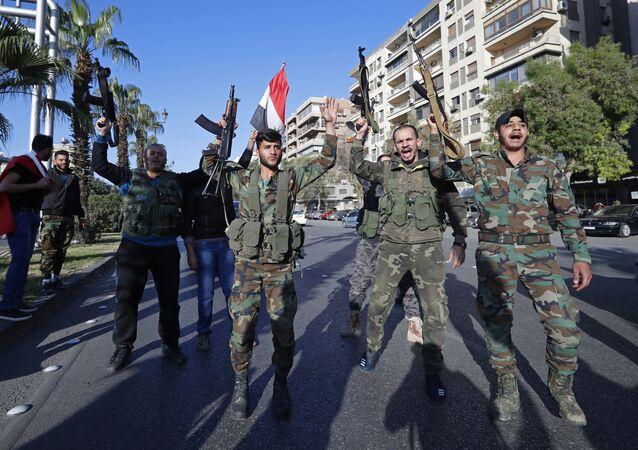 مظاهرات في دمشق بعد ليلة من هجوم التحالف الثلاثي، سوريا 14 أبريل/ نيسان 2018