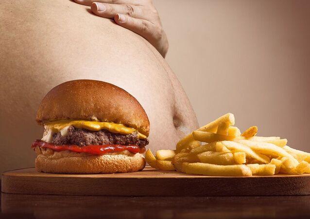 السمنة، الرجل السمين، زيادة الوزن، الأكل