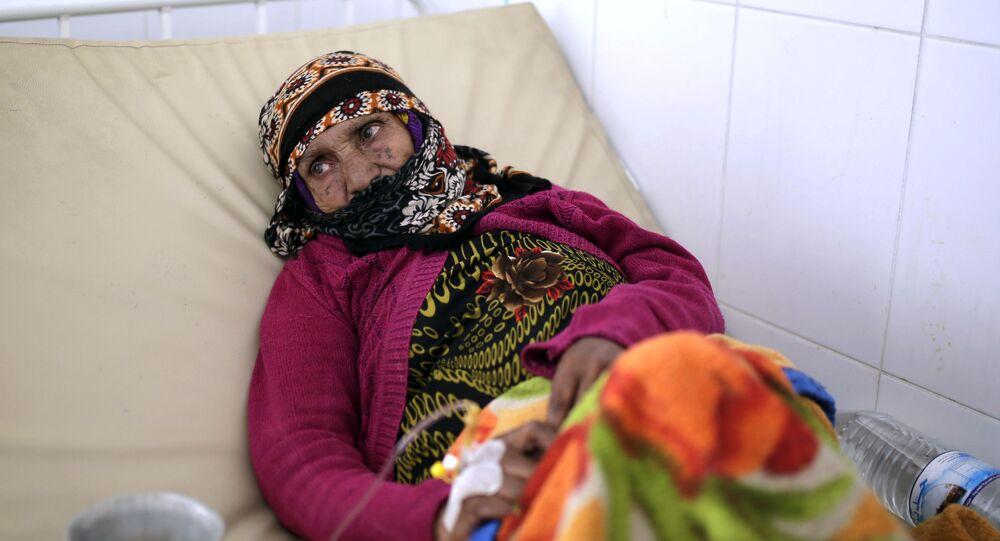امرأة يمنية تتلقى العلاج في مستشفى بالعاصمة صنعاء - 28 مارس/آذار 2019